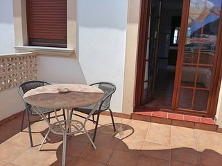 Terraza privada con sombrilla