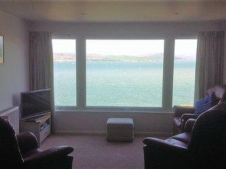 The lounge area enjoys beautiful views across the estuary to Rock. Sky TV is provided.