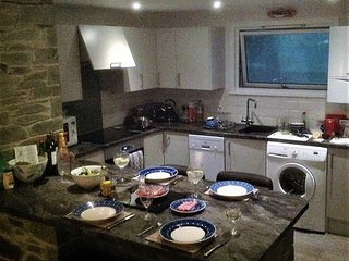 The kitchenette and dining bar is comfortable and well-appointed.