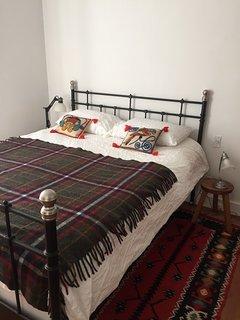 Bedroom #1 - queen size bed . Bedroom located on the lower floor