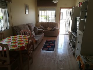 LA ZENIA HOUSE BUNGALOW GROUND FLOOR WITH SOLARIUM LA ZENIA 650 METERS TO BEACH.
