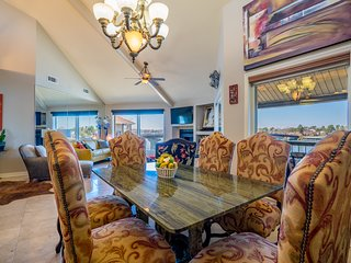 Granite table with comfortable seating for six. Dine in if desired. The kitchen is loaded for cooks.