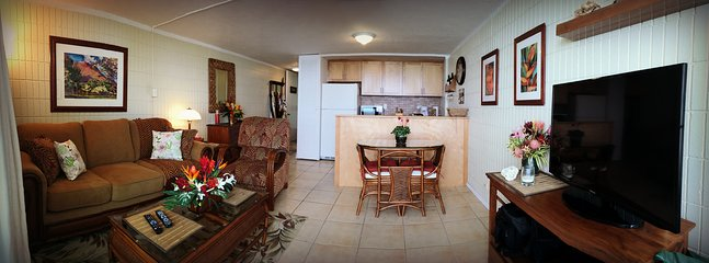 Living room, kitchen, and dining (dining now has a 4-top table).
