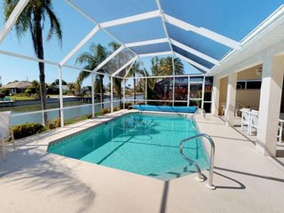 Enjoy Stunning Sunsets in this Cape Coral Fresh Water Canal Home with Tranquil V