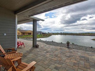 Waterfront suite w/ sunny patio, outdoor fire pit, lake views, and on-site golf