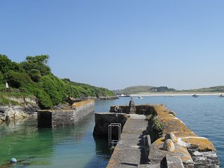 The Old Boatyard showing the harbour wall.