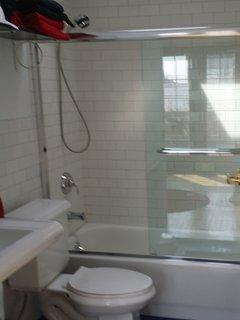 Upstairs bathroom with skylight