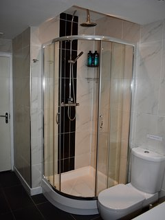 Ground floor bathroom with separate shower and giant whirlpool bath.