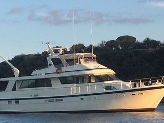 Stay on our 70' Hatteras Yacht in Monaco Sleeps 6