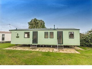 8 berth caravan at Cherry Tree Holiday Park, in Great Yarmouth. REF 70348