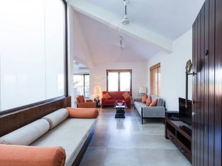 Entrance into the upper-level open plan living dining and kitchen area of this Holiday Home in North