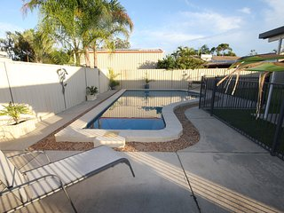 62 Tingira Close - Modern lowset family home with swimming pool, large outdoor e