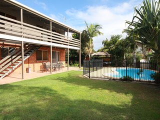 21 Kurrawa Drive - Pet friendly family home with balcony overlooking swimming po
