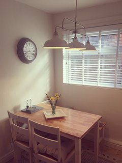 Kitchen-diner with farmhouse style table.