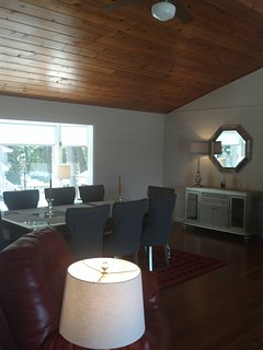 Formal Dinning Room with valeted ceilings and waterfront views.