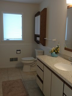 Upper Level shared Full Bathroom with tub and shower.