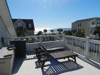 Ocean view balcony & a screened in deck overlooking private pool with Tiki bar
