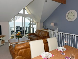 Beautiful Seaside Town House with Spectacular Coastal Views, Balcony and Parking