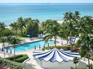 Sleek, modern condo with shared pool, hot tub, and ocean views!