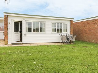 THE HEADLANDS, single-storey terraced chalet on holiday park, pet-friendly, on-s