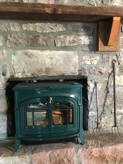A working wood stove in the living room.