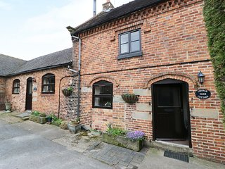 CHURCH FARM COTTAGE, pet friendly, character holiday cottage, with a garden in