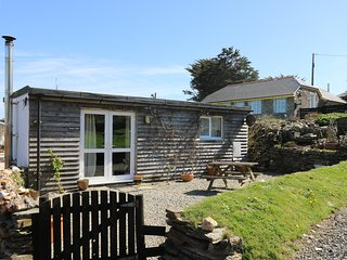 SUNNY CABIN, coastal views, sun-trap setting, woodburner, romantic retreat in