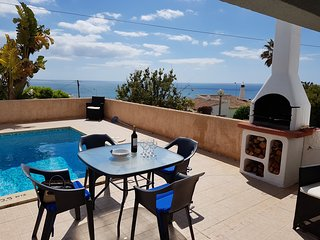 A fabulous detached house with private pool, garden and panoramic sea views.