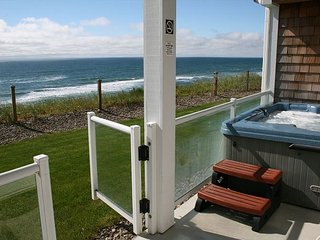 Upscale Oceanfront condo with private patio & hot tub.