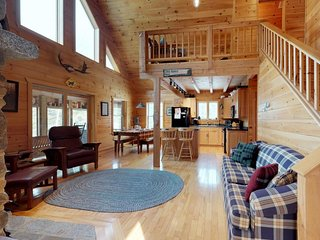 Secluded, waterfront cabin w/ screened porch, fire pit, dock, & pond access