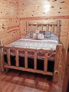 The third bedroom is equipped with a cozy queen-sized bed.