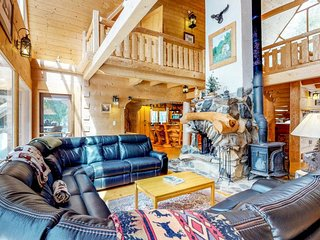 Custom lakefront lodge with private hot tub, game room, & tons of space!