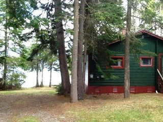 Two dog-friendly, lakefront houses with private beach, dock, and firepit
