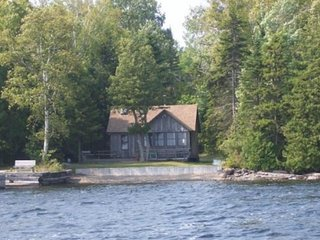 Lakefront cabin w/ pebble beach, permanent dock & deck w/ view - dogs welcome!