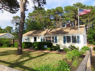 Cozy cape cod cottage with lovely wood floors and central AC.