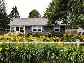 Nicely landscaped home offers three bedrooms in West Dennis neighborhood