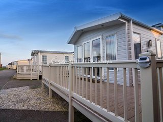 6 berth Lodge with D/G and C/H at California Cliffs Holiday Park. REF 50001O