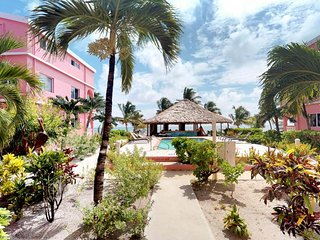 Spacious 1-bedroom oceanfront with shared pool steps from beach!