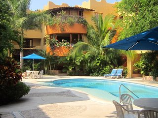 Luxurious Pool Side Condo, Ground Level.  Close to Beach & Town Center