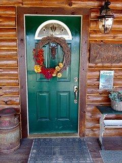 Front door welcomes you to Possum Lodge cabin rental.