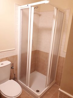 Shower room with toilet and vanity unit.