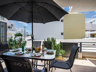 A parasol completes the terrace