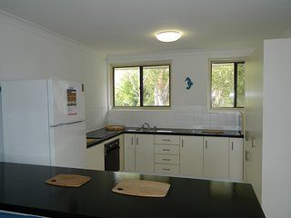 Full size kitchen with all the cooking appliances , bowls, plates, cups etc that you could need