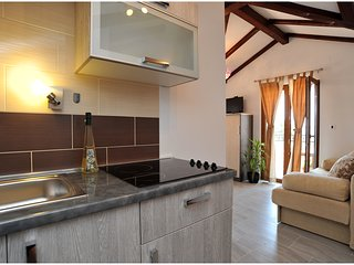 Apartment in stone house, in tourist center, close to beach and bus station