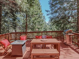 Large spacious deck includes fire pit, outdoor dining, and BBQ.