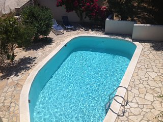 Apartment near Lakka with a pool