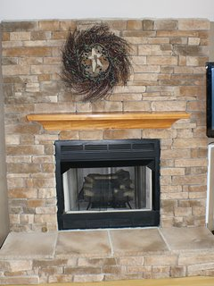 Stone fireplace (gas) in living room.