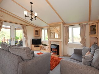 North Yorkshire Lodges Woodland Lodge with Private hot tub. Pet friendly!