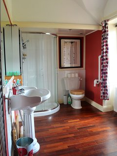 Family bathroom with freestanding bath and separate shower.