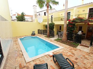 TV-60 - Spacious semi-detached V2 villa with shared pool and air conditioning